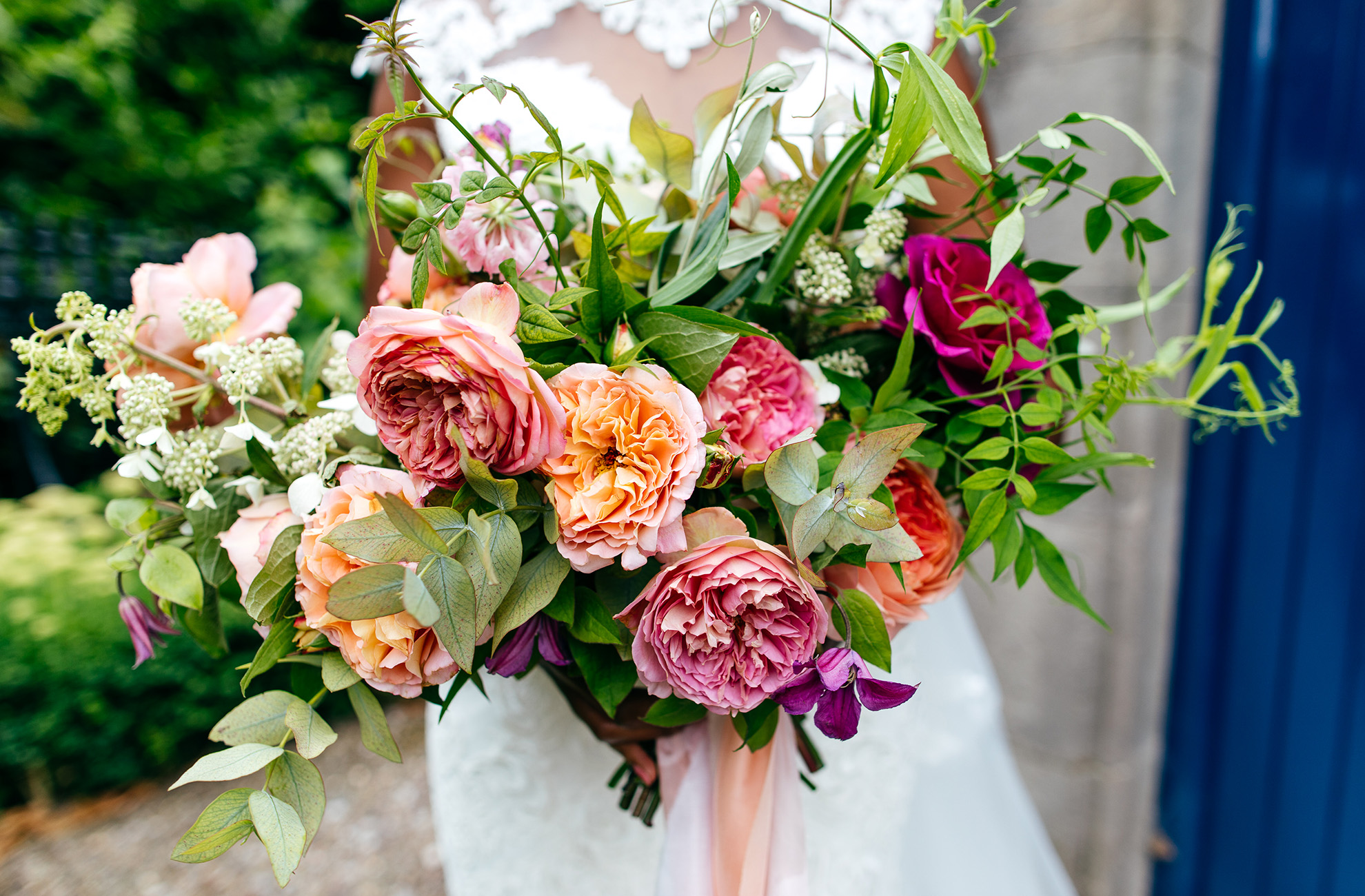 Add a pop of colour to your summer wedding at Combermere Abbey with a bright wedding bouquet