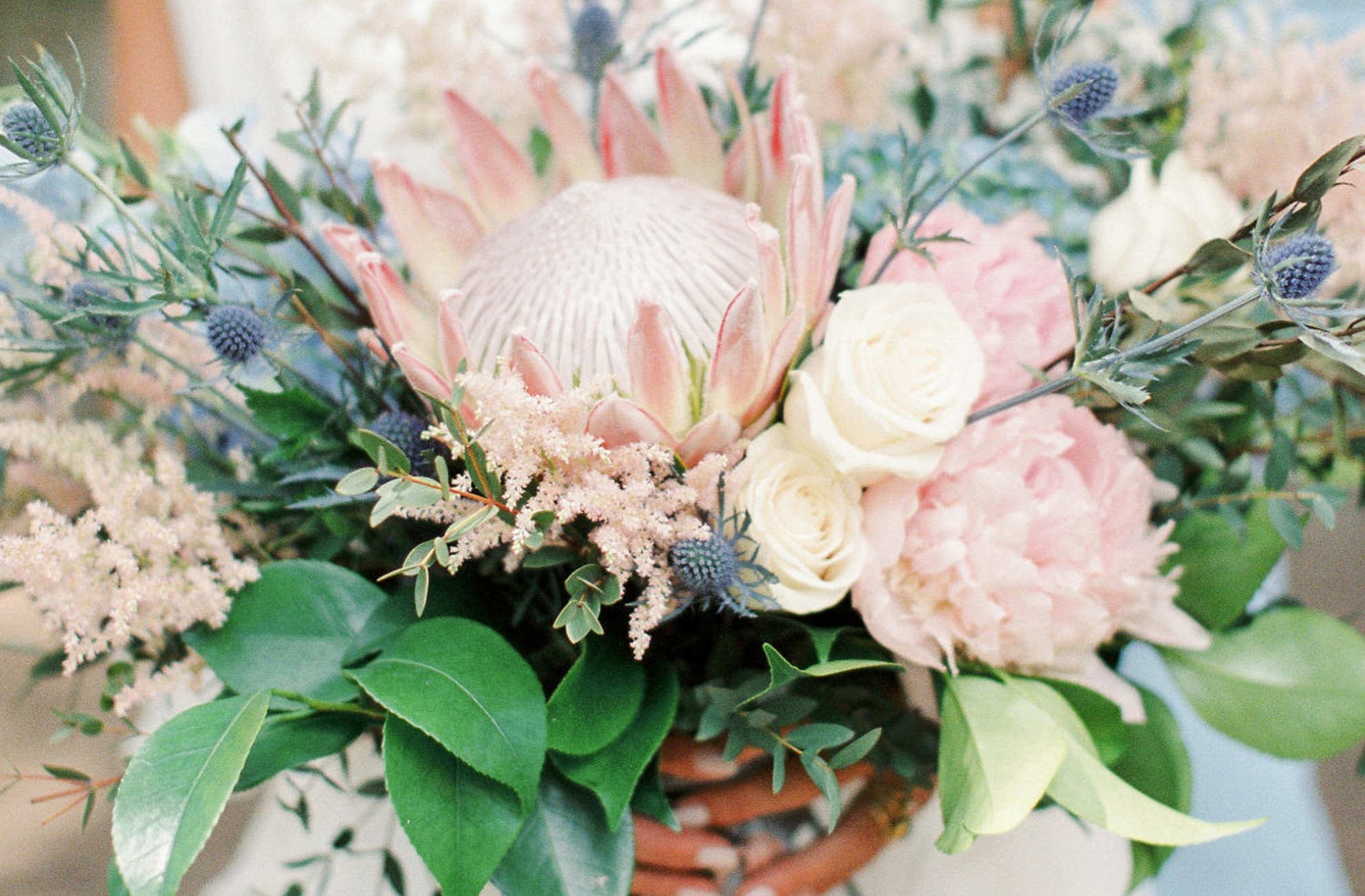 Exotic florals add a wow factor to a summer wedding bouquet at Combermere Abbey