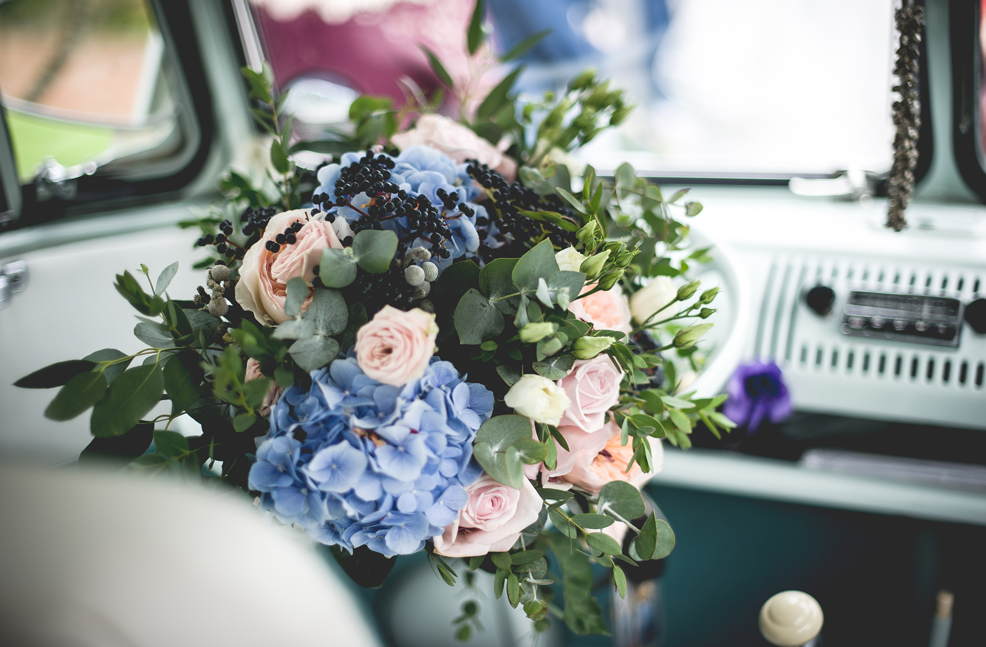 Garden wedding florals create beautiful wedding bouquets for a summer wedding at Combermere Abbey