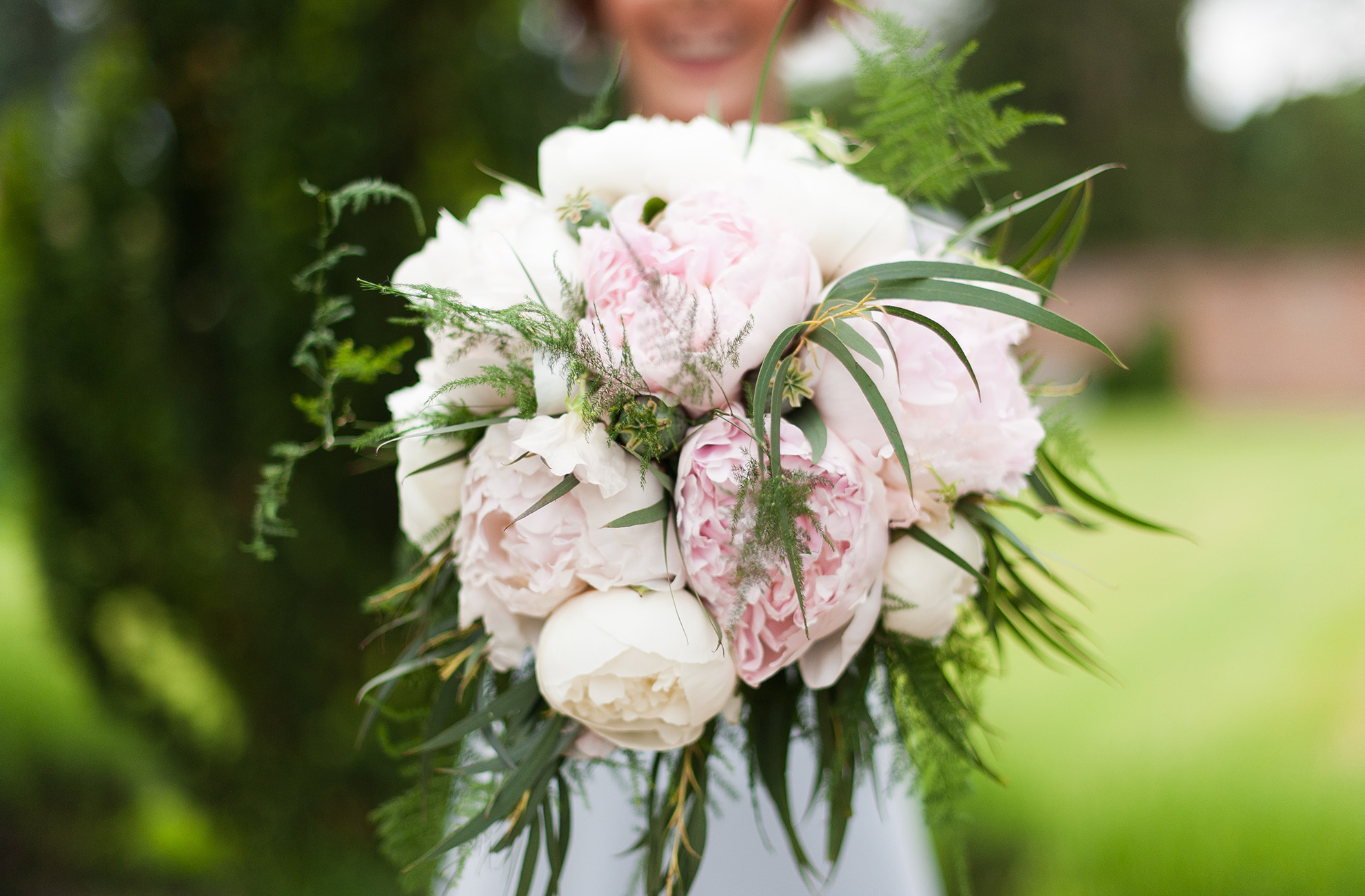 A bouquet of peonies smells amazing for a wedding at Combermere Abbey