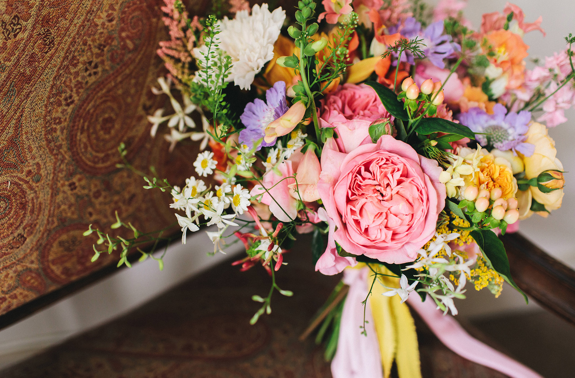 A vibrant summer wedding bouquet is perfect for a summer wedding at Combermere Abbey
