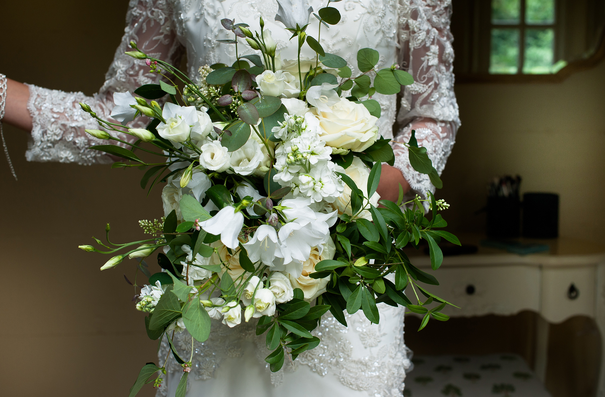 White floral bouquets surrounded by greenery are perfect for an elegant summer wedding at Combermere Abbey