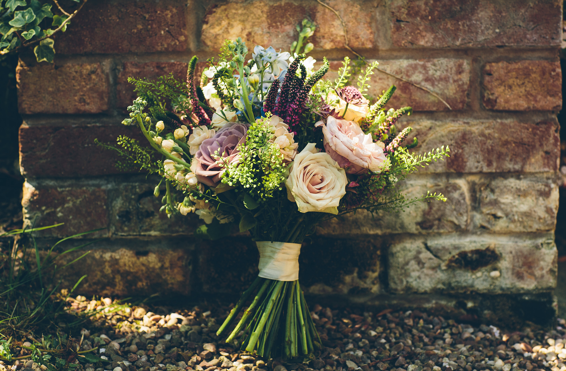 Wild flower bouquets always look good for a summer wedding at Combermere Abbey