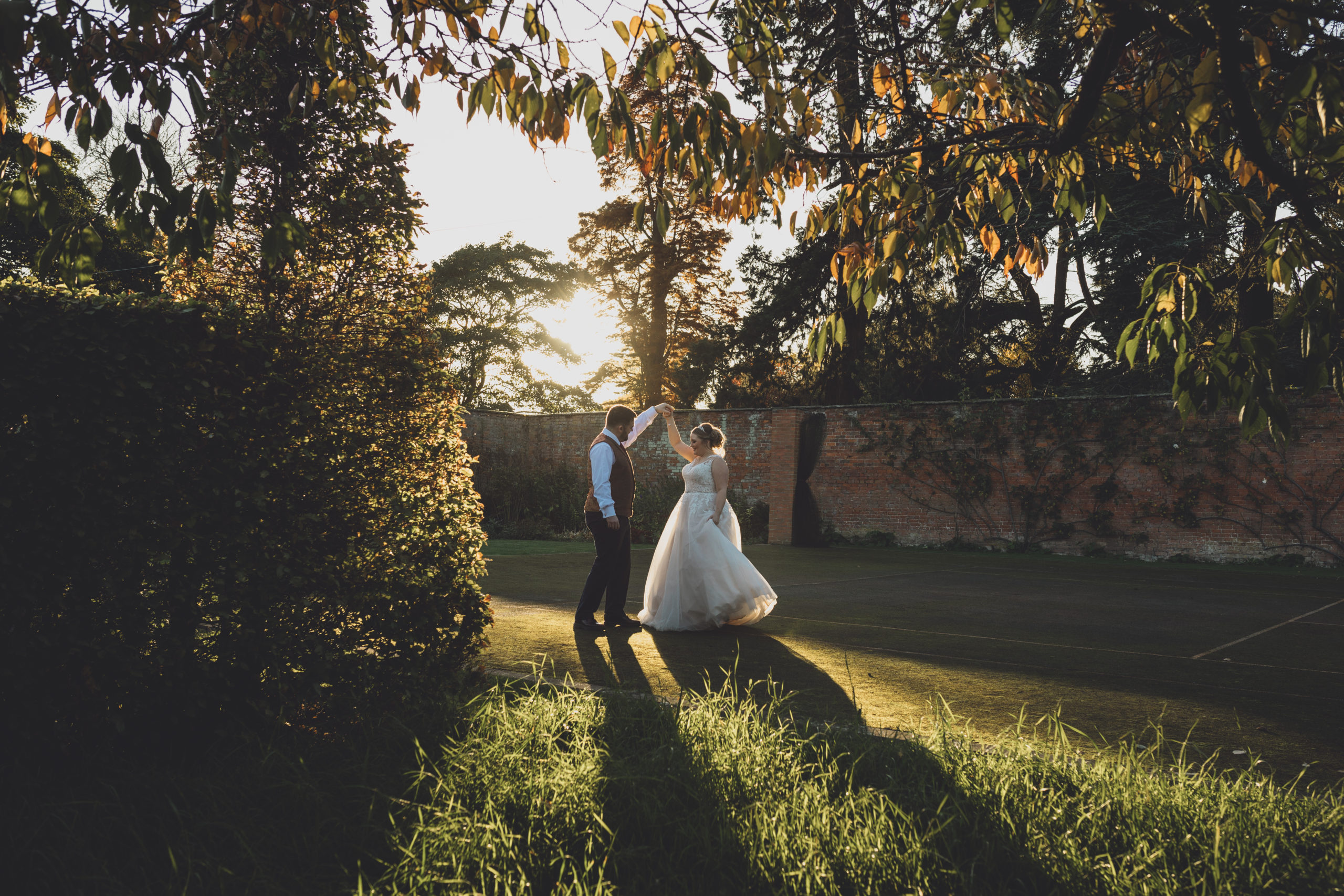 Golden hour wedding photography - a dance at sunset at Combermere Abbey